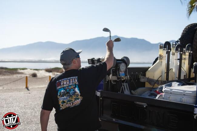 Jagged X Racing Bill Schueler preparing golf clubs at 2018 Baja 1000