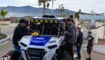 Jagged X Racing drivers take a look at their Polaris RZR at 2018 Baja 1000