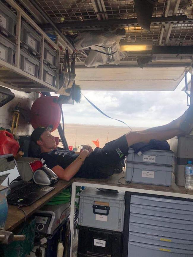 Shelby Ingrilli naps on the work bench waiting for the cars to arrive. Photo provided by Shelby Ingrilli