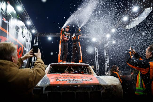 Justin Lofton Champagne spray after winning the 2019 Mint 400